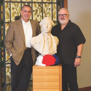 Author Jeff Finegan and artist Preston Keith Hindmarch pose with a bust of The Marquis de Lafayette, the subject of their third book, at the Special Collections & College Archives department of the Skillman Library at Lafayette College in Easton, PA.